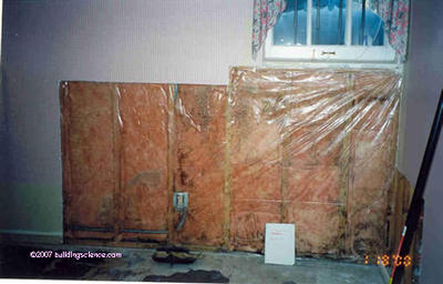 Photo_02: Interior frame wall with plastic vapor barrier